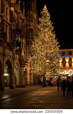 MUNICH, GERMANY - DECEMBER 25, 2009: Christmas tree at night with lights. Marienplatz square in Munich, Germany. Marienplatz is a central square in the city centre of Munich, Germany.