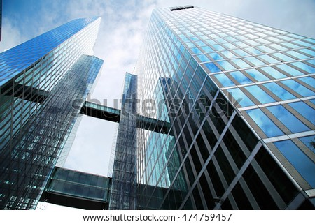 """MUNICH, GERMANY - JULY 31: modern skyscraper """"Twin tower"""" in Munich on July 31, 2016. Offices of different companies and hitel are located in this building. #474759457"""