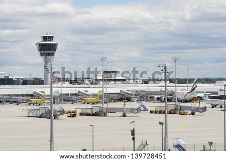 MUNICH, GERMANY - MAY 20: The Airport of Munich, Germany on May 20, 2013. Flight preparation for a A380 and other planes. Last year the passenger number of the airport was almmost 30 million.