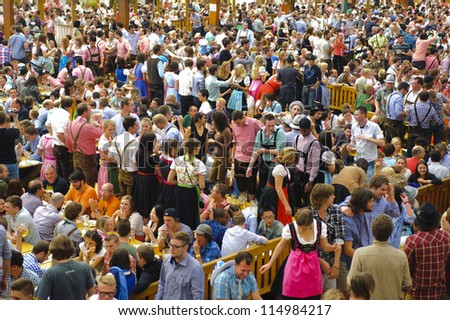 "MUNICH, GERMANY - OCT 3: beer tent with dancing people at world biggest beer festival ""Oktoberfest in Munich"" on October 3, 2012 in Munich, Germany"