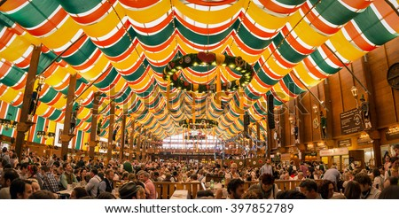 Munich, Germany- October 2, 2014:  People drinking in the Hippodrom Beer Tent on the Theresienwiese Oktoberfest fair grounds Photo stock ©