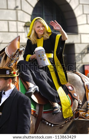 MUNICH, GERMANY - SEPTEMBER 23: a girl represents the talisman for Munich and participates in the opening parade of world biggest beer festival Oktoberfest on September 23, 2012 in Munich, Germany.