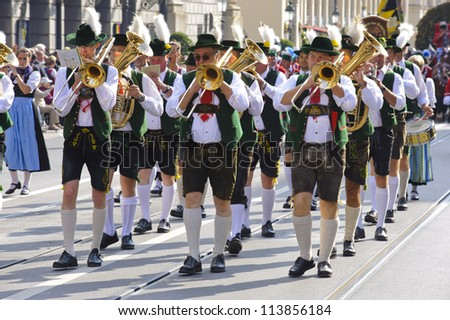 MUNICH, GERMANY - SEPTEMBER 23: a music band in traditional bavarian clothes participates in the opening parade of world biggest beer festival Oktoberfest on September 23, 2012 in Munich, Germany.