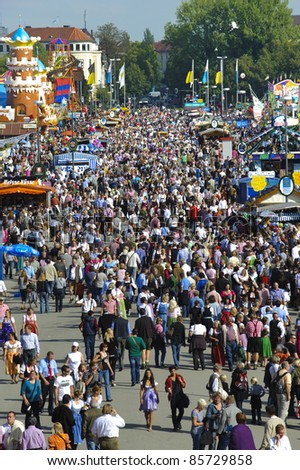"MUNICH, GERMANY - SEPTEMBER 21: panorama view to the visitors of world biggest beer festival ""Oktoberfest in Munich"" on September  21, 2011 in Munich, Germany"