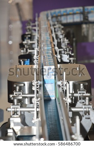 MUNICH, GERMANY - SEPTEMBER, 2013: The production line for the production of milk in Tetra-Pak package