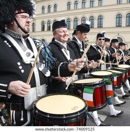 MUNICH - MARCH 13: irish drummers marches at the St. Patrick's day on March 13, 2011 in Munich, Germany. This national irish holiday takes place annually in March in Dublin and other european cities.