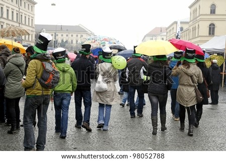 MUNICH - MARCH 11:people in irish hats celebrates St. Patrick's day on March 11, 2012 in Munich, Germany. This national Irish holiday takes place annually in March in Dublin and other European cities.