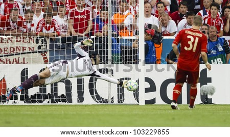 MUNICH, MAY 19 - Cech of Chelsea (L) saves the penalty of  Schweinsteiger during FC Bayern Munich vs. Chelsea FC UEFA Champions League Final game at Allianz Arena on May 19, 2012 in Munich, Germany.