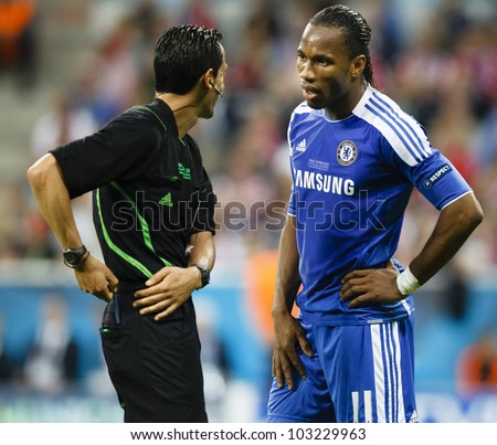 MUNICH, MAY 19 - Didier Drogba of Chelsea (R) and referee Proenca during FC Bayern Munich vs. Chelsea FC UEFA Champions League Final game at Allianz Arena on May 19, 2012 in Munich, Germany.