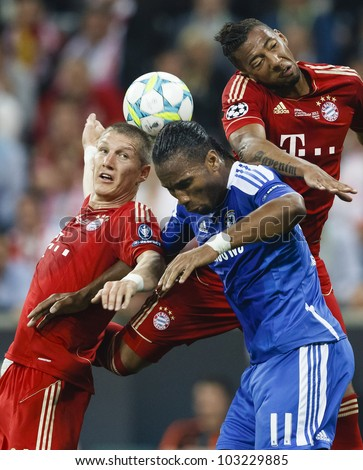 MUNICH, MAY 19 - Drogba of Chelsea, Schweinsteiger (L) and Boateng of Bayern during FC Bayern Munich vs. Chelsea FC UEFA Champions League Final game at Allianz Arena on May 19, 2012 in Munich, Germany