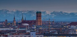 Munich skyline aerial view at winter in background alps mountains. Munich church frauenkirchr cityscape, germany city.