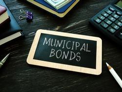 Municipal bonds written on the small blackboard.