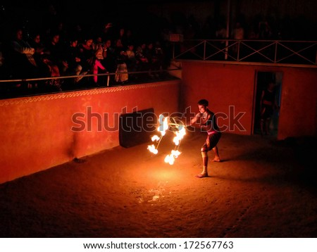 MUNNAR, INDIA - JANUARY 2: Man performing fire dance in the Thirumeny cultural centre on January 2, 2014 in Munnar, Kerala, India.