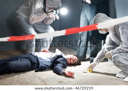 Murder scene with two forensic analysts and a lieutenant investigating a crime on a businessman in a basement