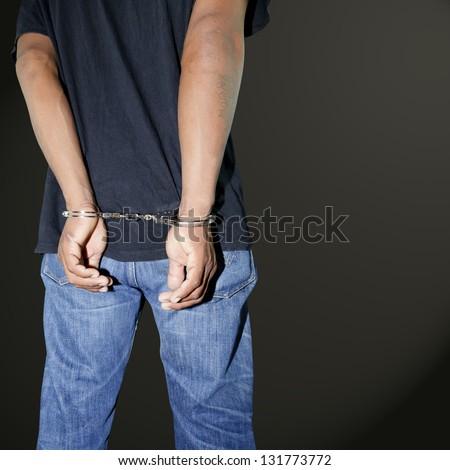 Murderer locked in handcuffs