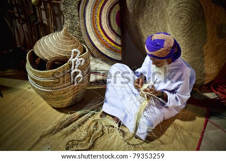 Muscat, Oman - February 2011: Unidentified Omani Man demonstrates one of the traditional Omani craftsmanship at the yearly Muscat Festival.