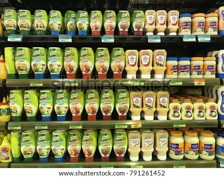 Muscat , Oman - 25 November 2017 : Assorted local and international mayonnaise displays on the supermarket shelf. #791261452