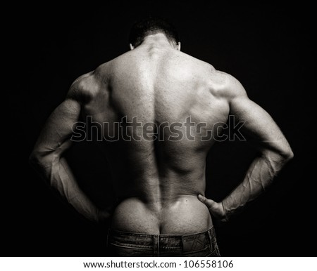 free photos muscle man back on black background avopix com