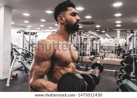 Muscle man doing bicep curls. Muscle man doing bicep curls