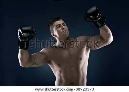 Muscle man, lots of muscles, working out, loving life. Very well built, very attractive. Boxing, Boxing Ball.