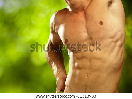 muscle man on a nature background