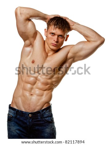 Muscle sexy wet naked young man posing in jeans - stock photo