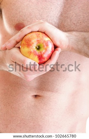 Muscle sexy wet naked young man torso and red apple in hands diet
