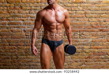 muscle shaped underwear man with weight on gym brick wall