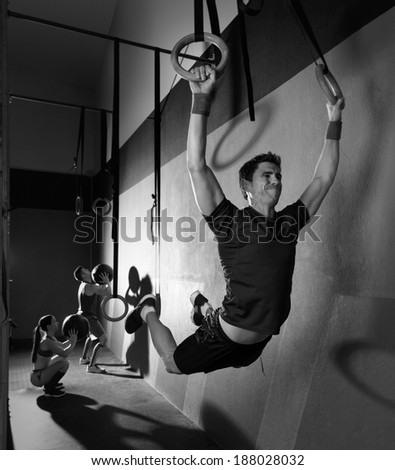 Muscle ups rings man swinging workout exercise at gym
