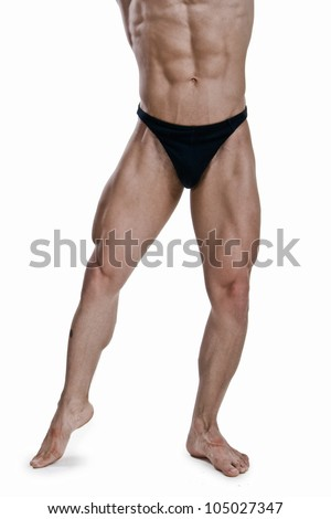 Muscled legs of a male model on white background