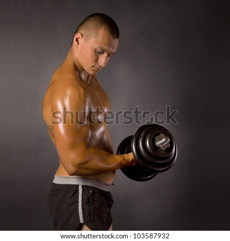 Muscled male bodybuilder weight, dumbbell, raise, swing