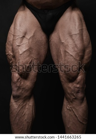 Muscled male legs on isolated background