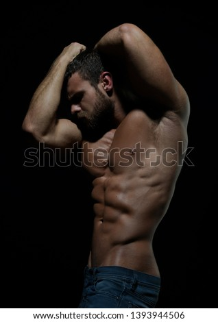 Muscled male model in a studio