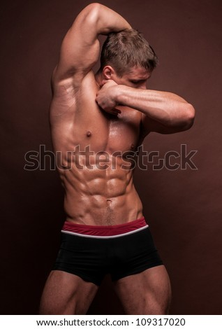 Muscled male model in expressive pose