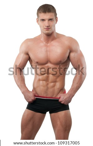 Muscled male model on isolated white