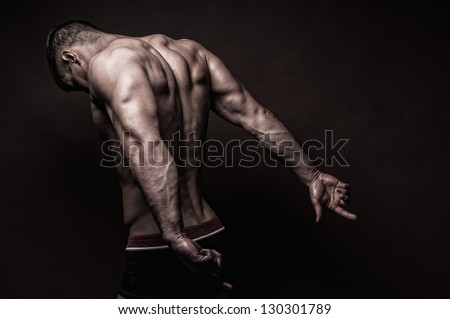 Muscled male model with strong arms