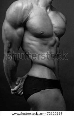 Muscled male torso in black and white