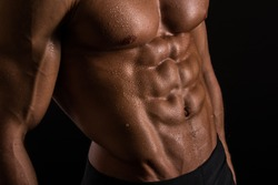 Muscled male torso with abs