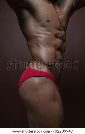 Muscled male torso with abs #702209947