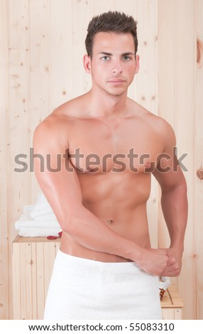 muscled man with towel