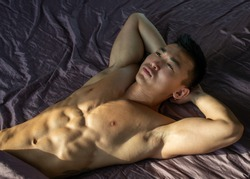 Muscled shirtless asian male model