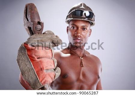 Muscular African American iron worker