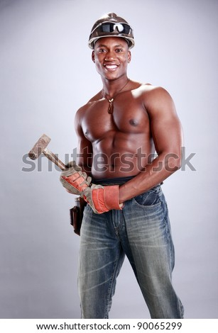 Muscular African American iron worker - stock photo