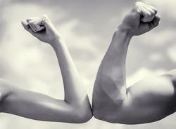 Muscular arm vs weak hand. Vs, fight hard. Competition, strength comparison. Rivalry concept. Rivalry, vs, challenge, strength comparison Black and white