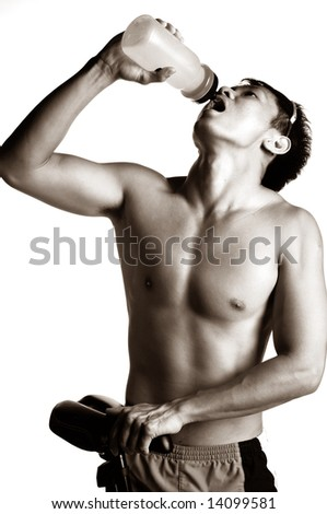 muscular asian man hydrating himself