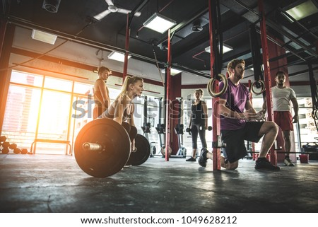 Muscular athletes training in a fitness studio - Functional training workout in a gym #1049628212