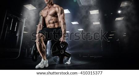 muscular bodybuilder doing...