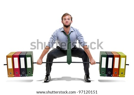 Muscular businessman lifting weights made of heavy files