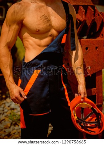 Muscular concept. Muscular body in working uniform. Muscular activity. Muscular strength and power. #1290758665
