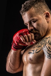 Muscular fighter posing with boxing gloves
